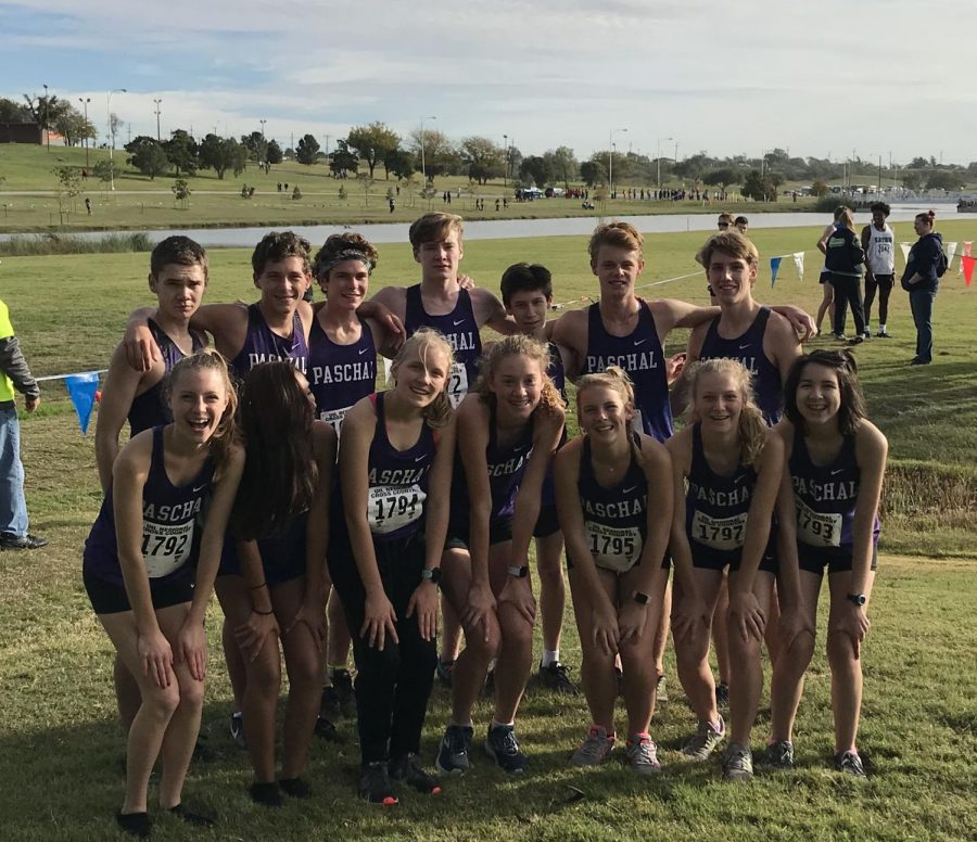 The varsity cross country team at the 2018 Regional Meet. Top row (left to right): Whit Dennis, Aidan Hunter, James Barham, Reid Smith, Isaac Stacey, Charlie Schwartz, and Patrick Estes. Bottom row (left to right): Haleigh Cox, Brooklyn Mariscal, Rykhr Grissom, Ella Barrett, Lauren Hammer, Anne Schuster, and Bernadette Gonzalez