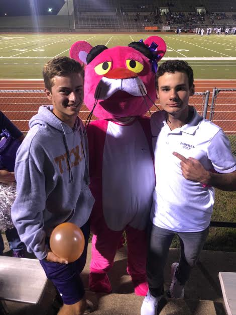 Junior+Nathan+Moore+and+Senior+Keegan+Galvin+pose+with+the+Pink+Panther+at+the+Homecoming+Game.
