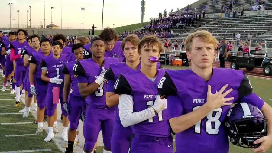 The+Paschal+varsity+team+respecting+the+flag.+%28Photo+from+https%3A%2F%2Fwww.star-telegram.com%2Flatest-news%2Fqnogak%2Fpicture219532990%2Falternates%2FLANDSCAPE_1140%2F20181004_185838.jpg%29