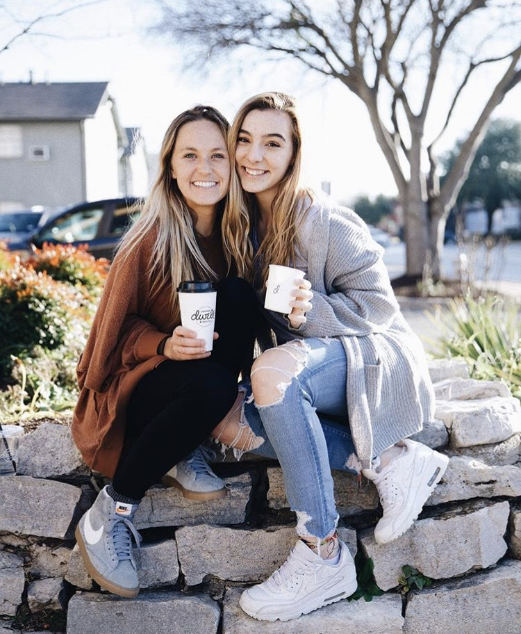 Paschal student, Ava Crum poses for a picture with TCU student and YoungLife leader, Ellie Haskins outside of Dwell.  Picture credits to @dwellcoffeeandbiscuitsfw