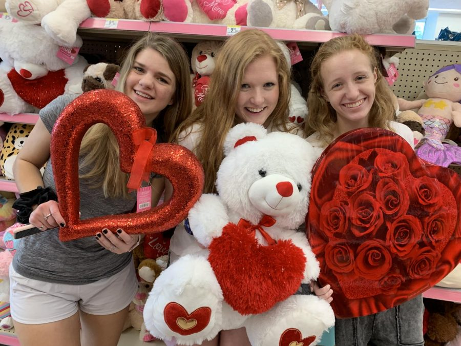 senior+girls+Abby+Sympson+and+Jessica+Puckett%2C+and+junior+Lily+Fields+shop+for+Valentine%27s+Day+goodies.