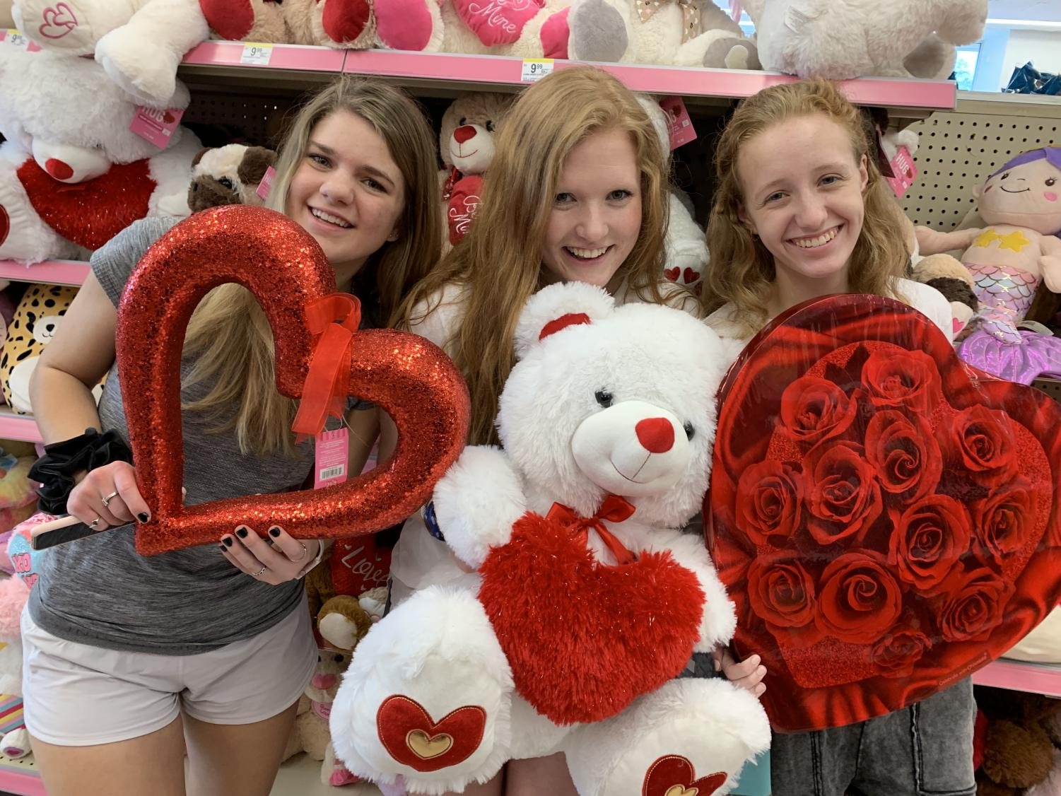 senior girls Abby Sympson and Jessica Puckett, and junior Lily Fields shop for Valentine's Day goodies.