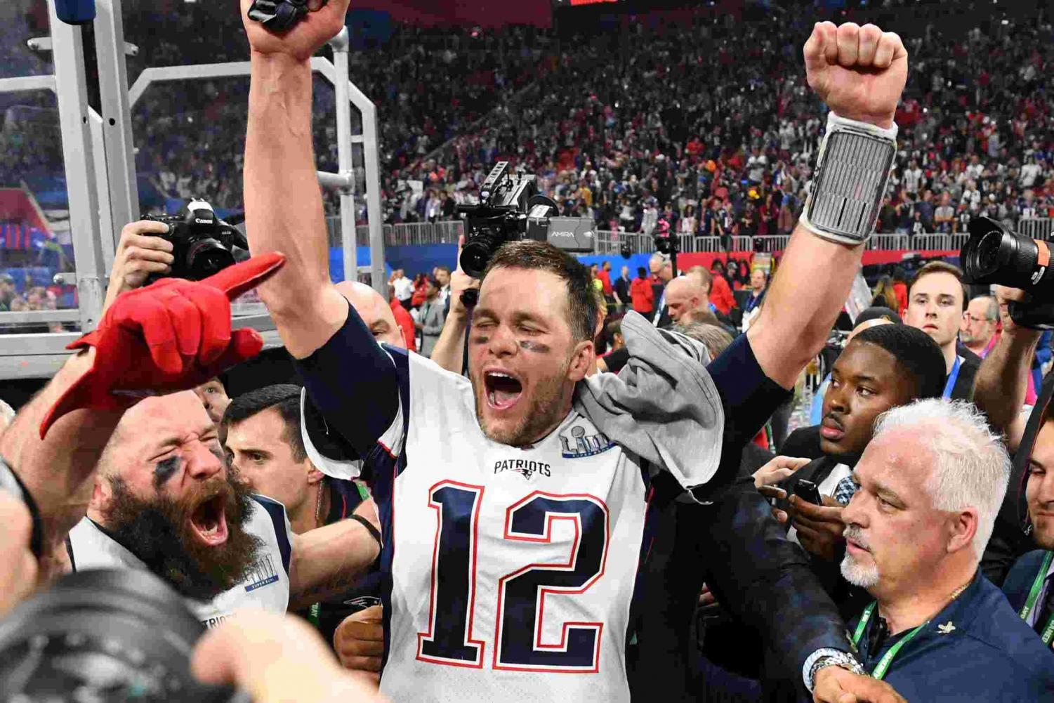 Tom Brady celebrates with Super Bowl MVP Julian Edelman following Sunday's victory.