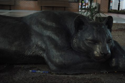 """The Sleeping panther"" lying down at the proposed sighting of the downtown panther,  located at the corner of Main and Weatherford."