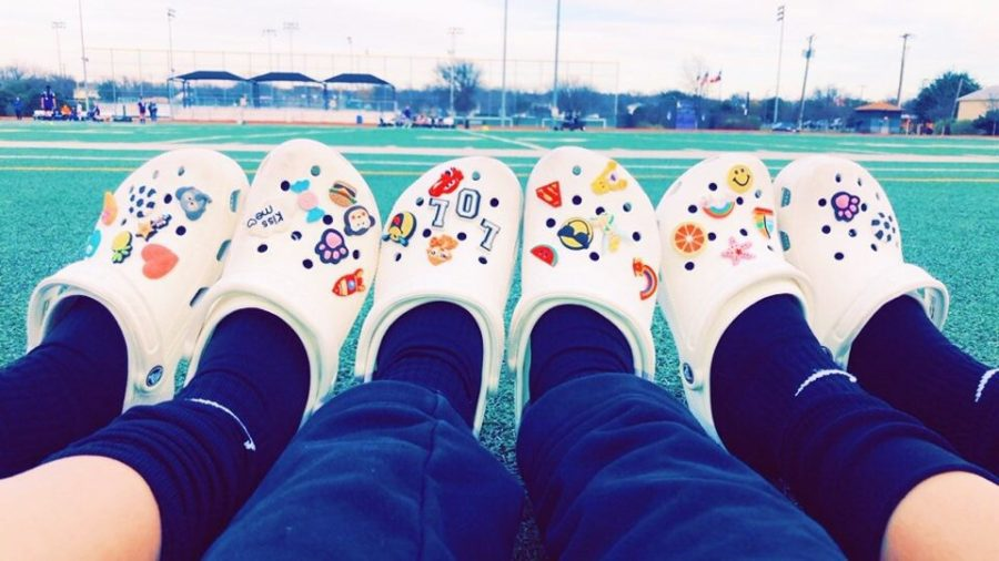 Varsity+soccer+girls+sport+their+colorful+crocs.