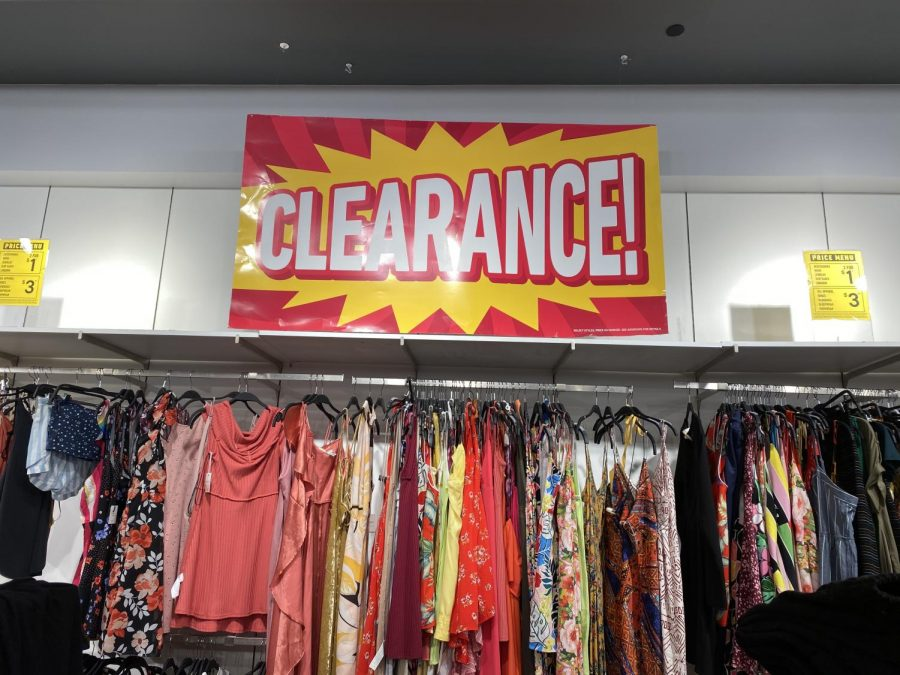 Store clearance display above an array of picked over remains of the store.
