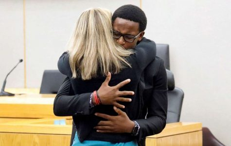 Brandt Jean hugs Amber Guyger in a moment of forgiveness at the trial  that determined her consequences.
