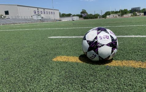 A soccer ball on an empty Paschal field.