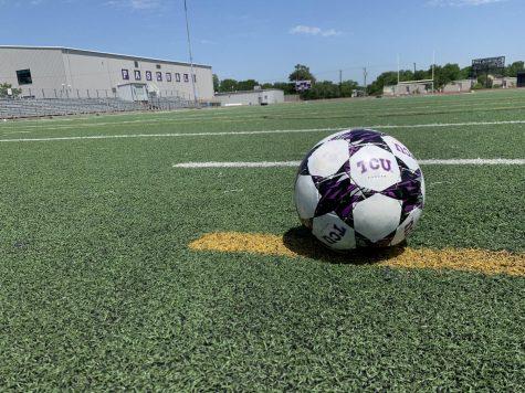 A soccer ball on an empty Paschal field.