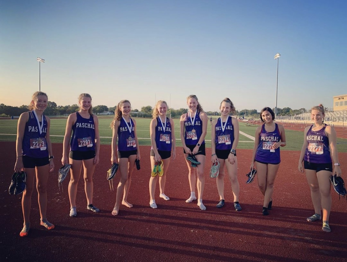 The girls varsity cross country team after their first place win at the Spartan Invitational. From left to right: Eme Barrett, Cate Schuster, Hadley Schrimpf, Anne Schuster, Ella Barrett, Anderson Berger, Brooklyn Mariscal, Lauren Hammer