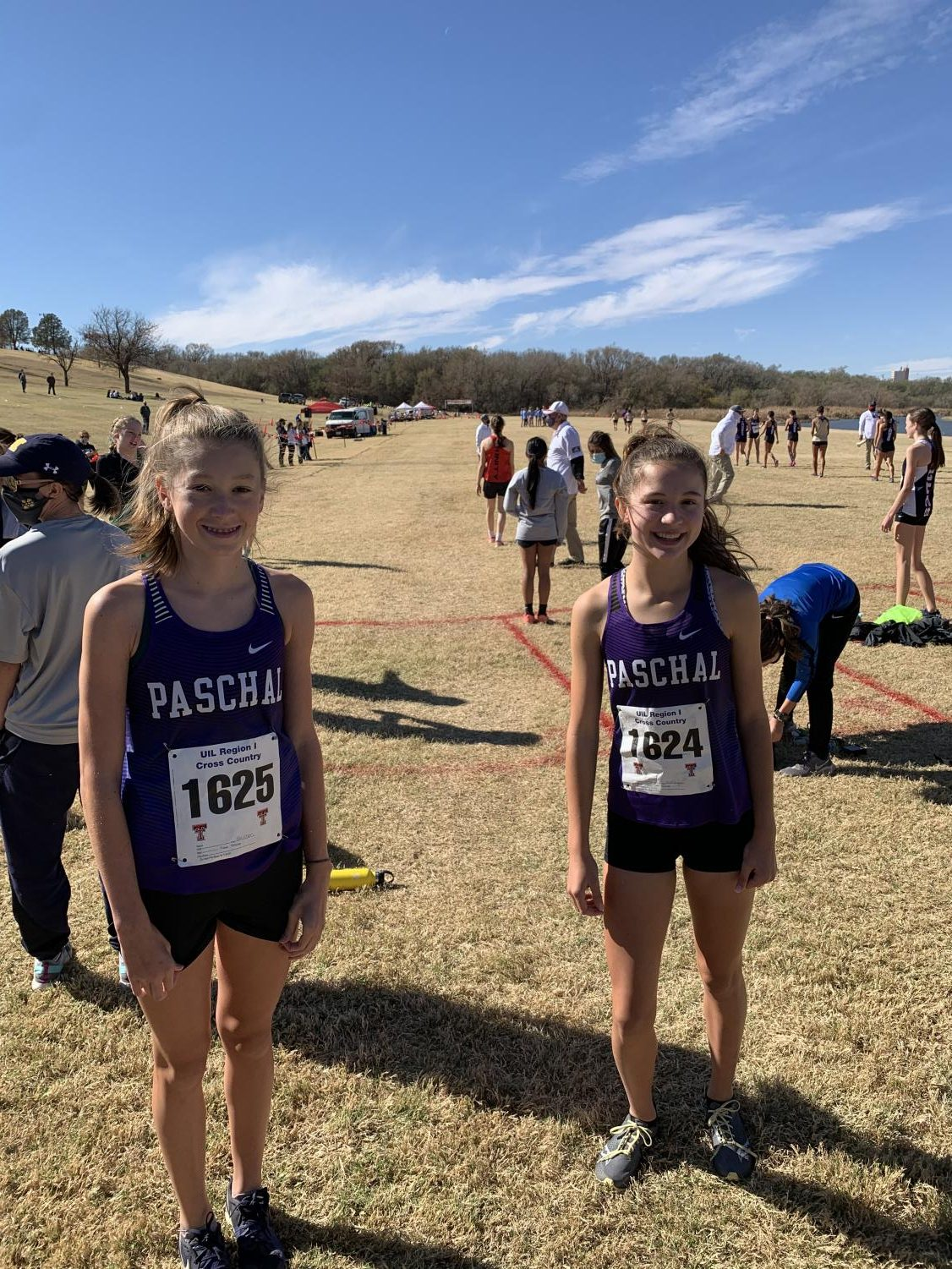 Emerson Barrett and Hadley Schrimpf on the starting line at the Region 1 Championship Meet.