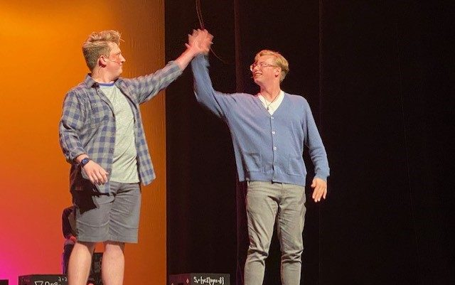 Thomas Powderly and Ethan Johnson high five during the performance of their duet